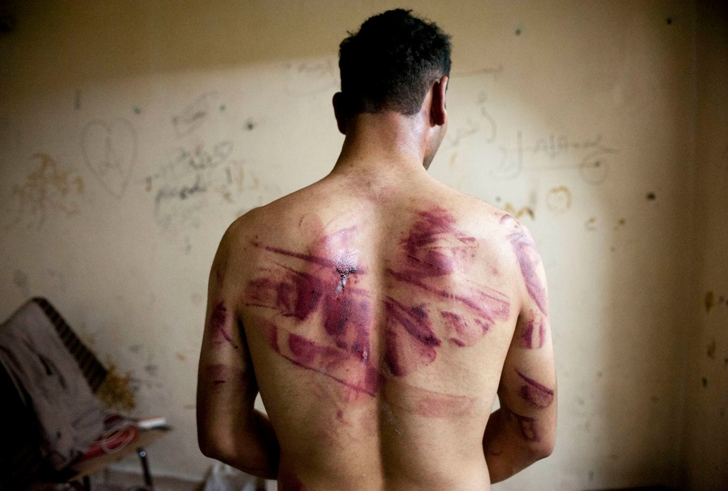 Syrian forces use widespread sexual violence to humiliate and silence male prisoners, new report says