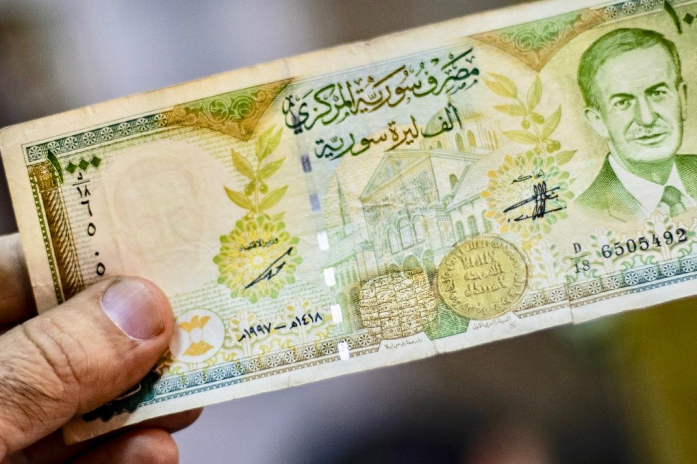 Syria's Assad raises penalty on foreign-currency use to seven years hard labour