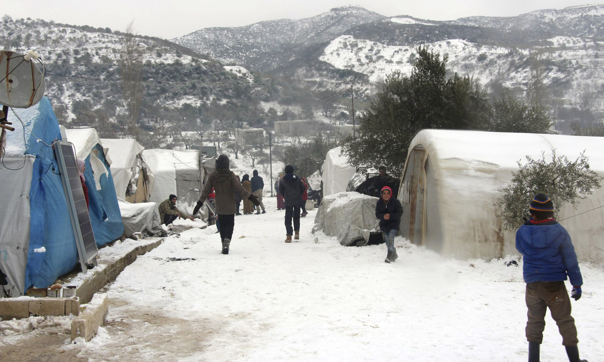 Families trapped by Assad's assault on Idlib fight to survive in the snow